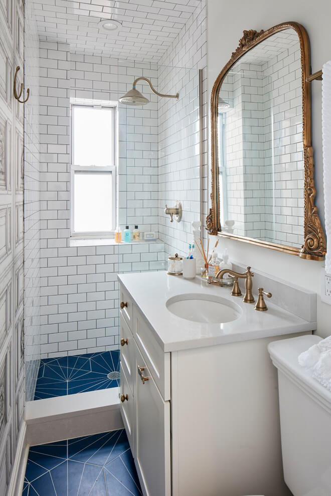 Gold accents and patterned floors in baths