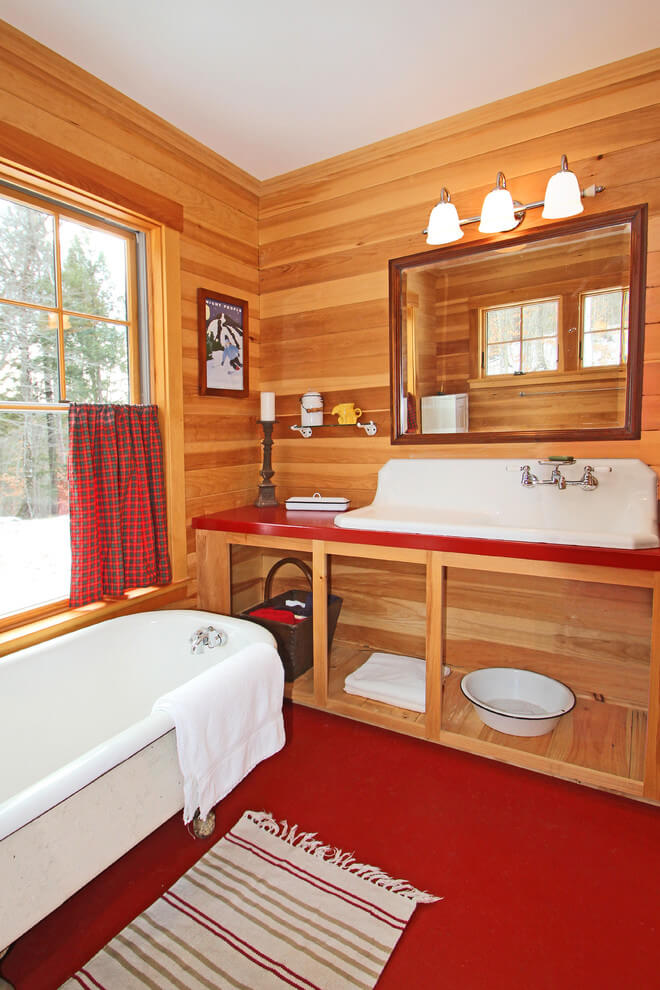 Rustic bathroom with red floor
