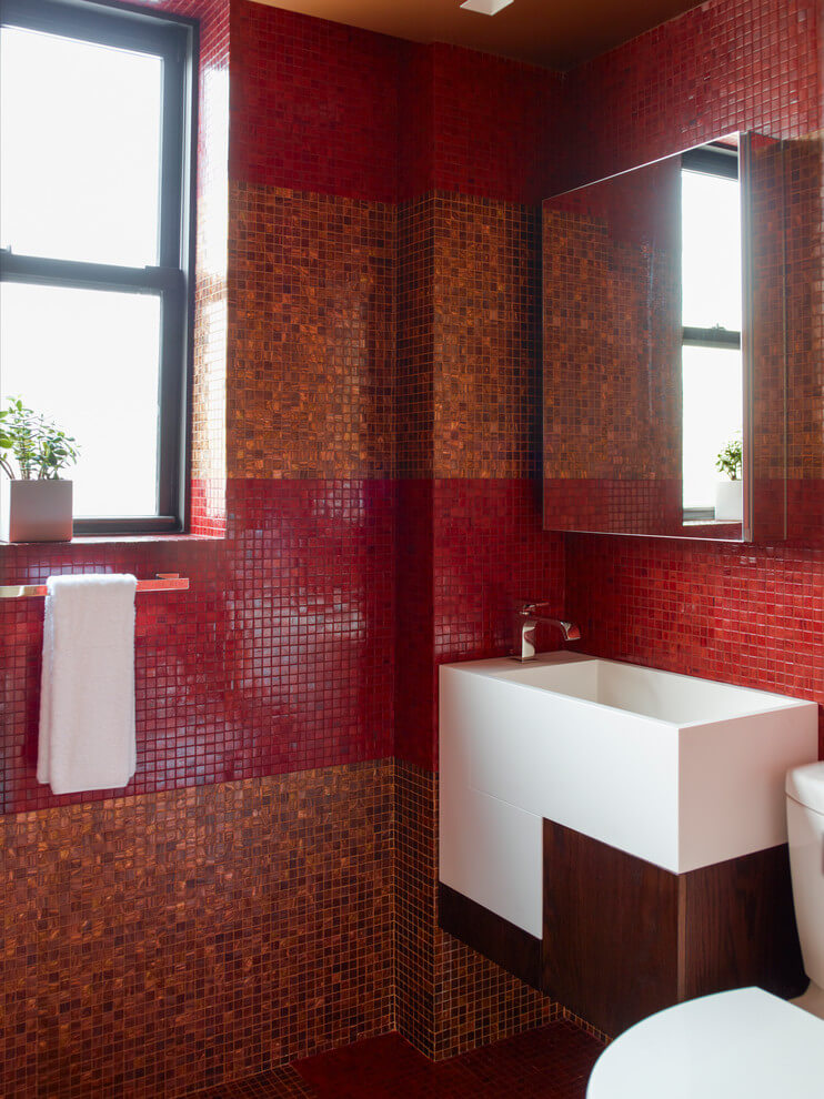 Amber and red tiled bathroom