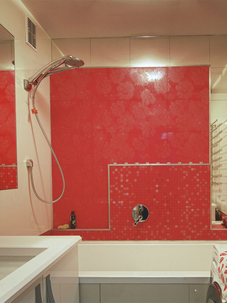 Modern bathroom with red accent wall