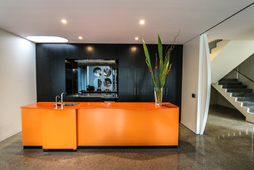Modern orange and black kitchen