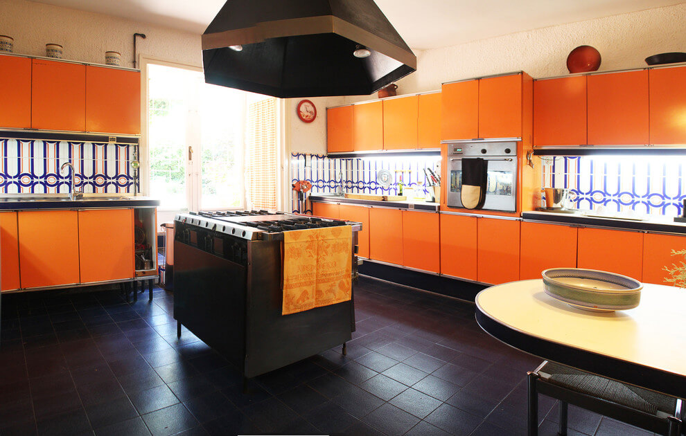 Large kitchen in orange and black