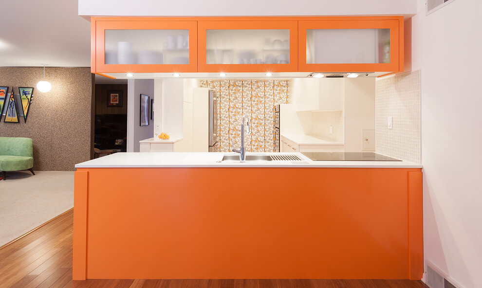 Bright orange and white kitchen