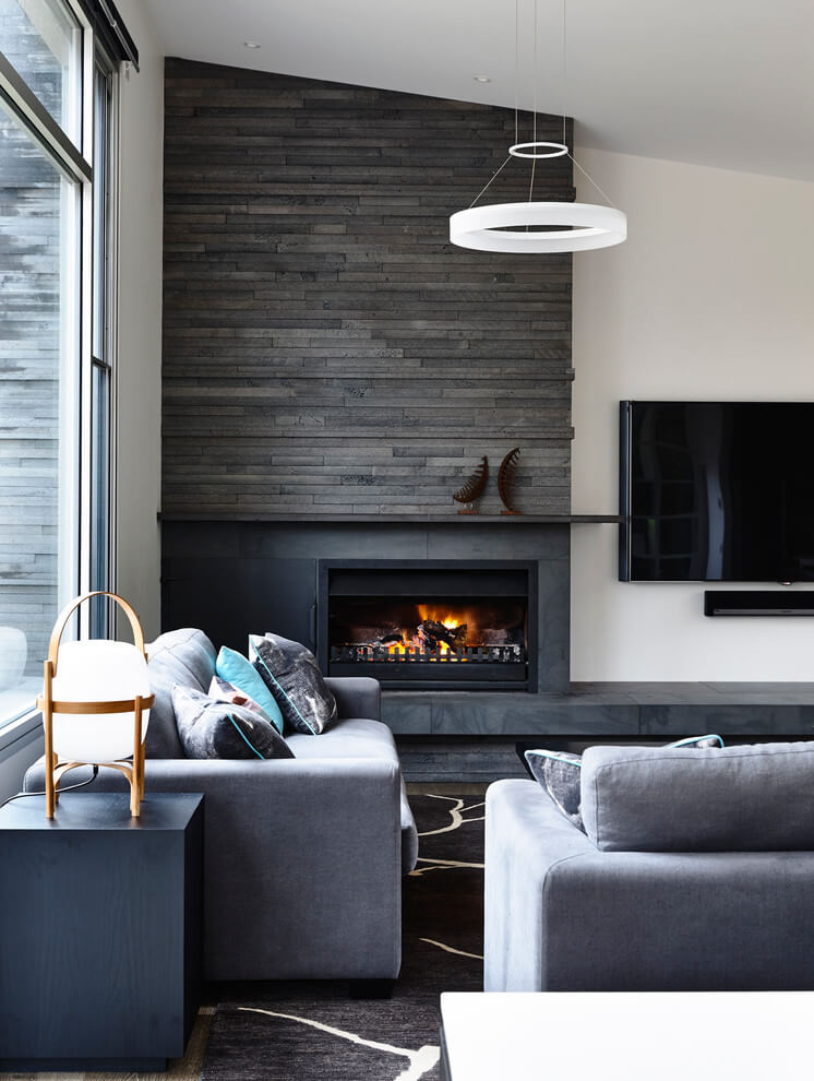 Living room accent wall in dark colors