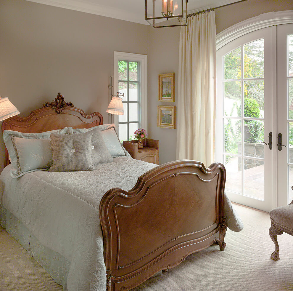 Warm earthy French bedroom design