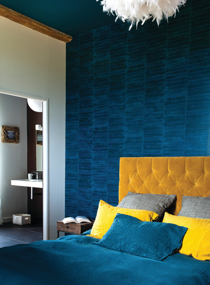 Yellow accents in blue bedroom