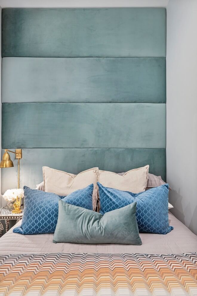 Simple bedroom with turquoise headboard