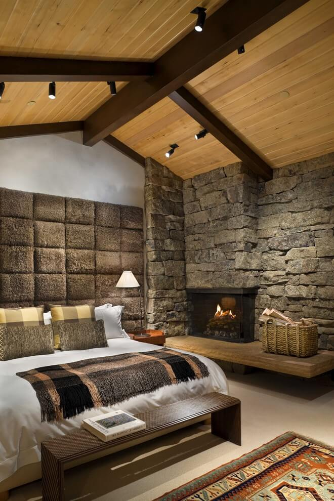 Rustic bedroom with fireplace in the corner