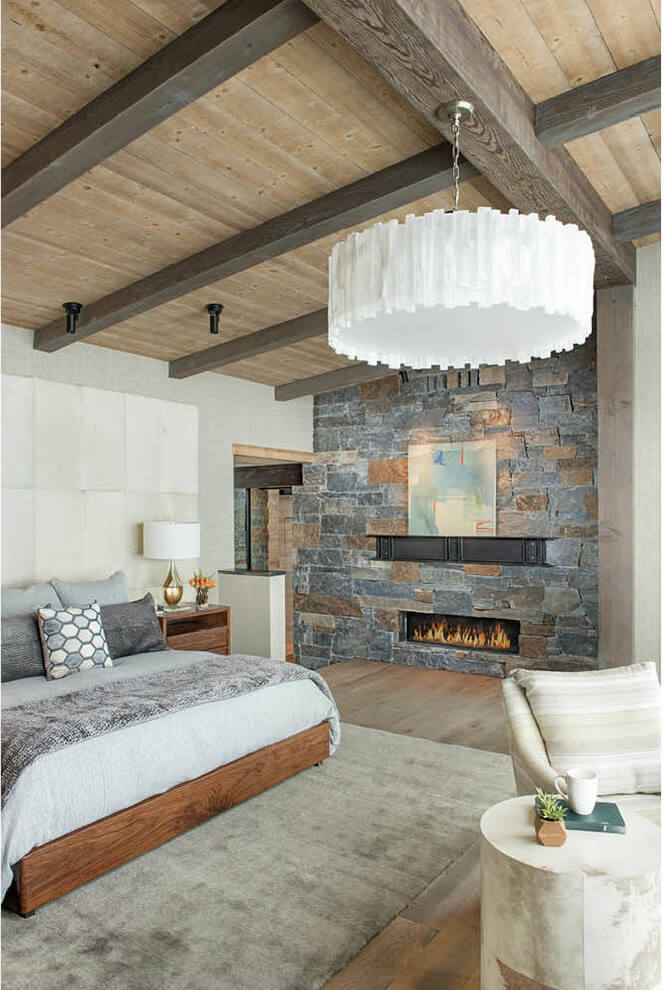 Stone wall stove in rural bedroom