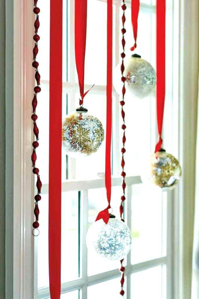 Window decor in festive red gold