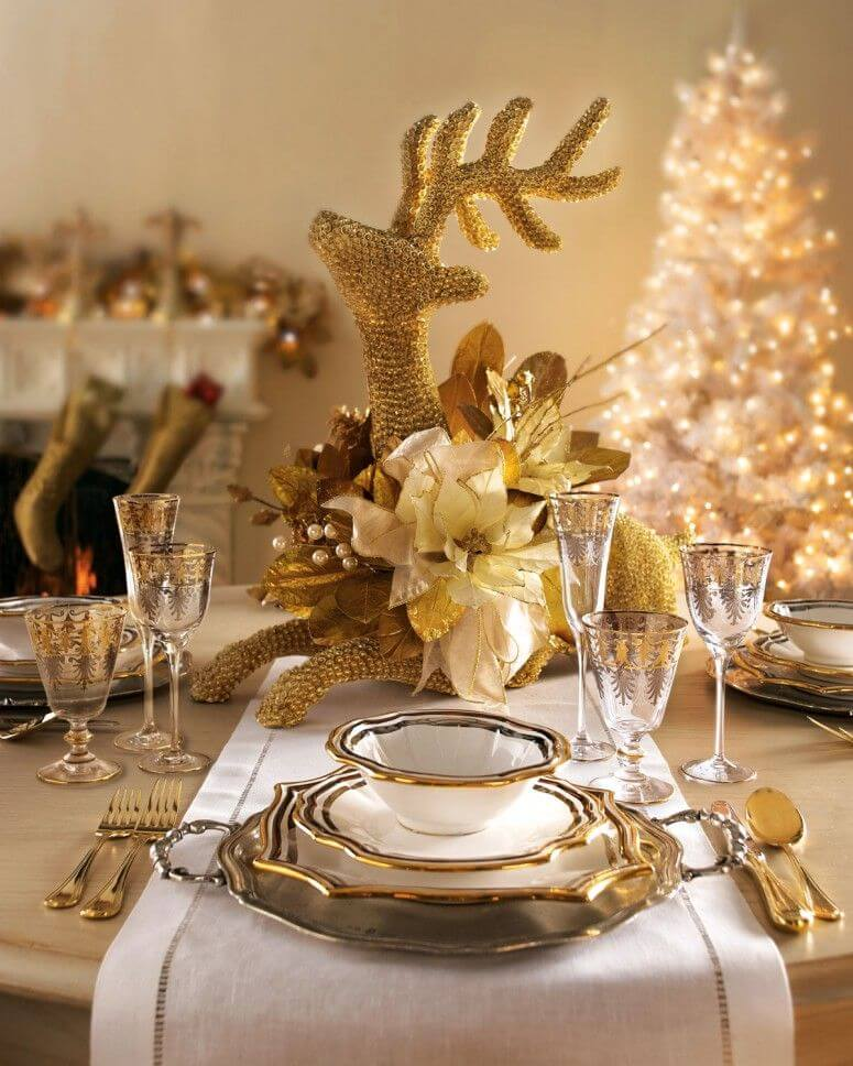 Glamorous setting of gold Christmas table