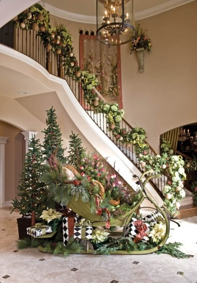 Elaborate sleigh and garland decor