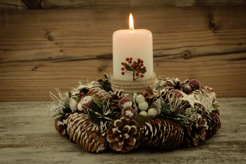Rustic candles and pine cones center piece