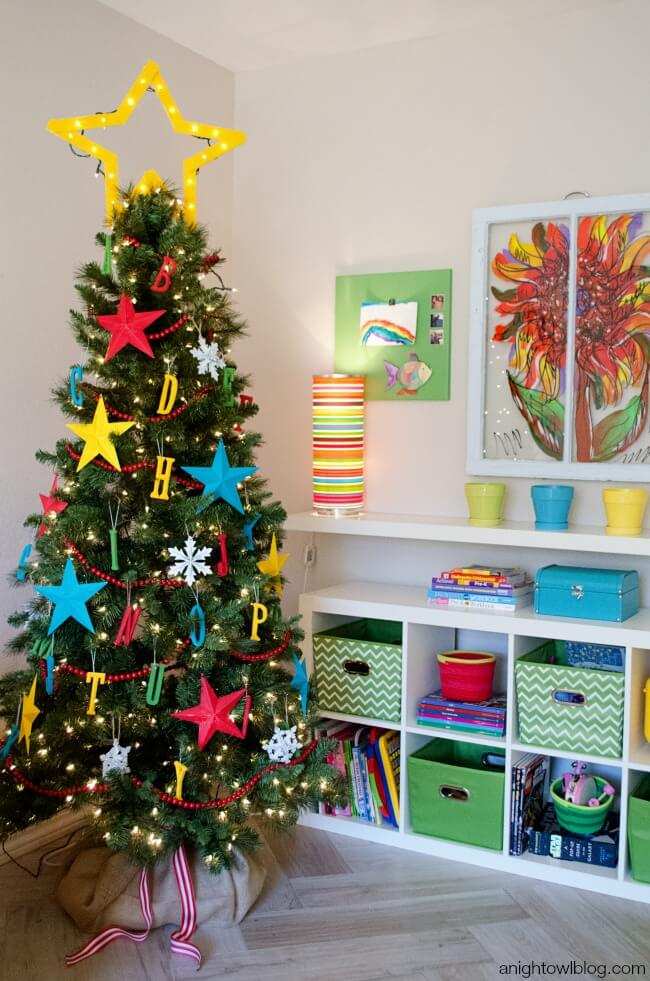 Colorful children play Christmas tree