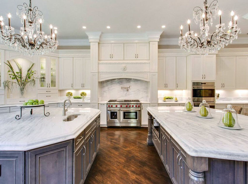 White cabinets Two islands and chandeliers chandeliers in marble