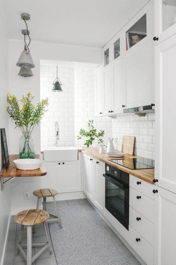 White brick wall small space kitchen