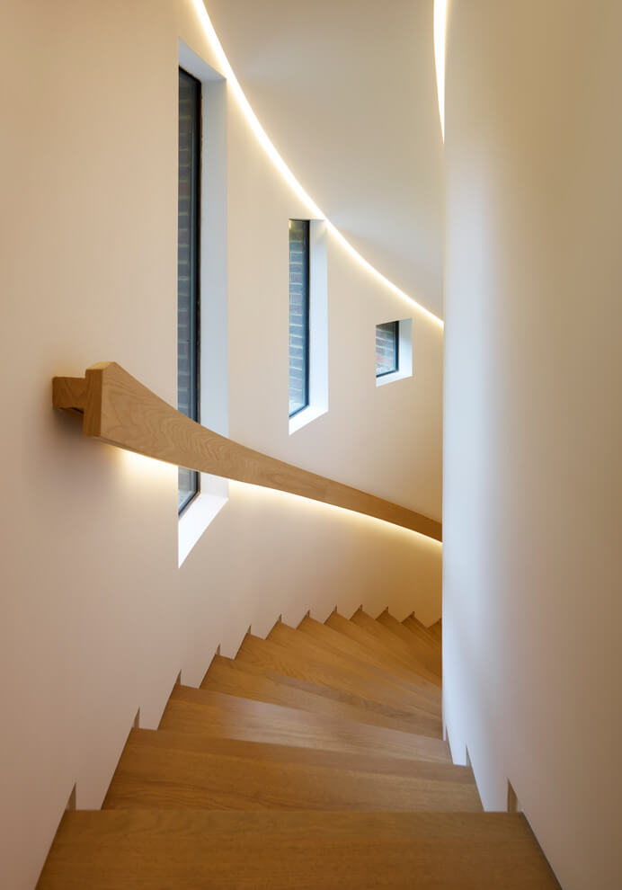 Spiral staircase wall and railing light