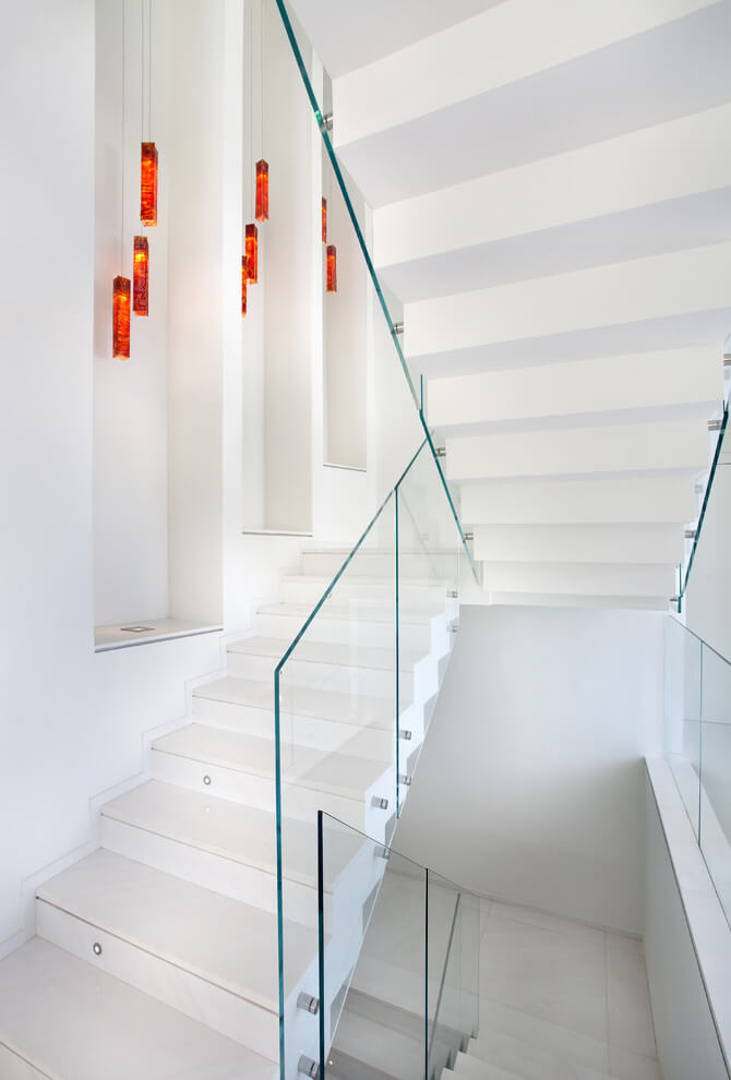 White staircase walls with hanging lights