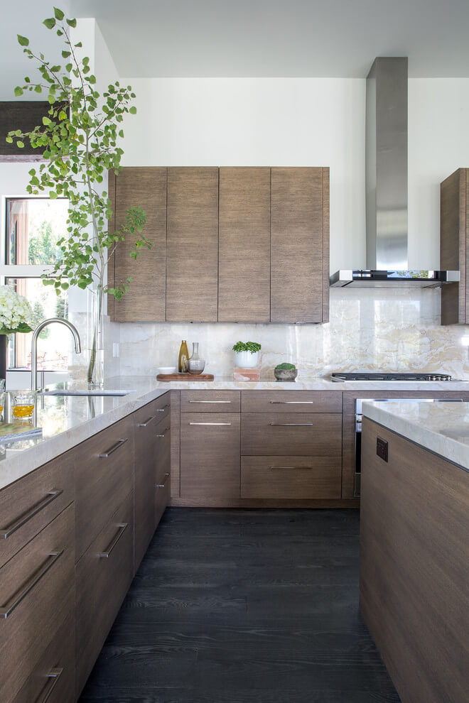 wooden cabinets and marble countertops