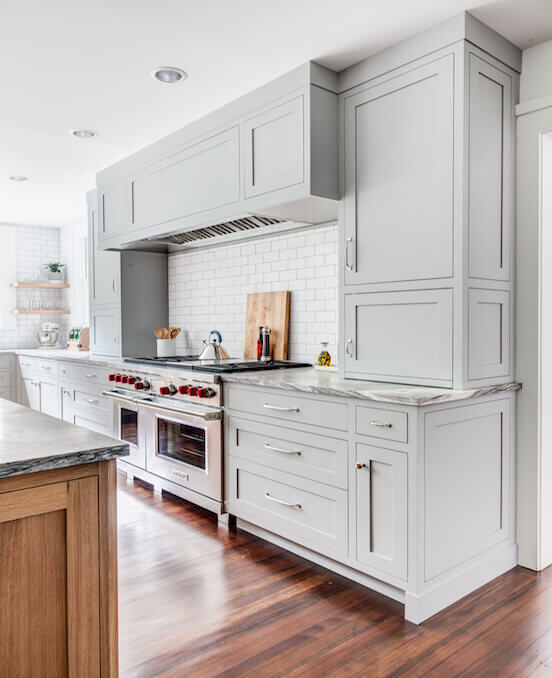 Gray kitchen cabinets with white wall plates