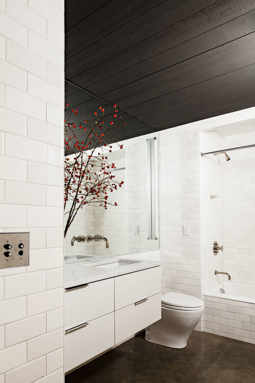 wooden beams white tile bathroom