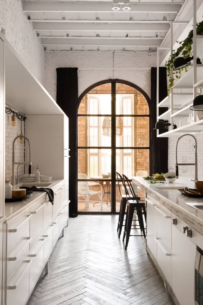 kitchen counter open shelves arched doors