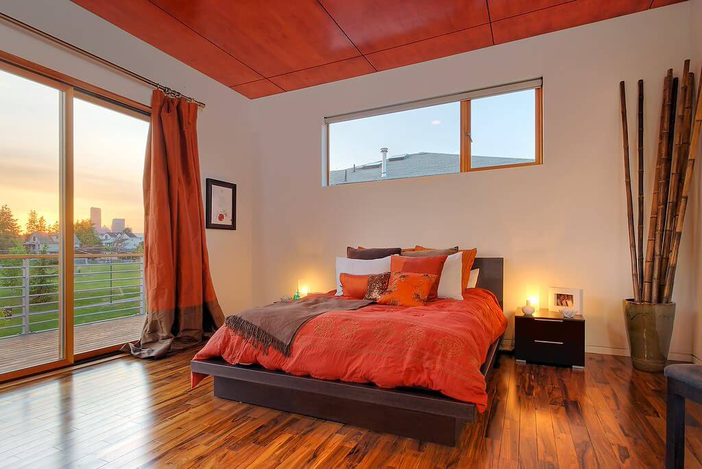 Solid orange curtains Minimalist Medium Tone wood flooring modern bedroom