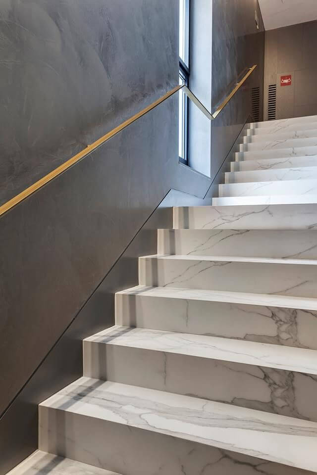 Attractive design of white marble stairs