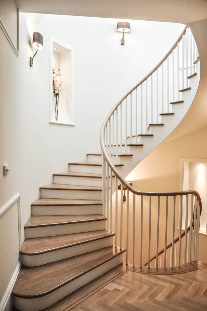 Traditional classic wooden curved stairs