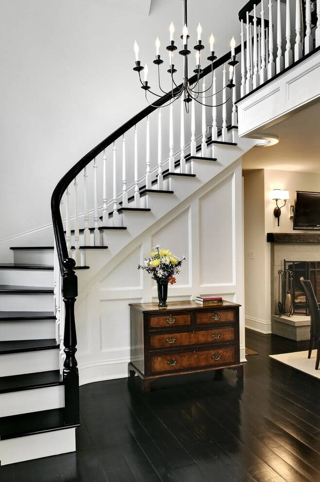 Traditional staircase with black wooden floors