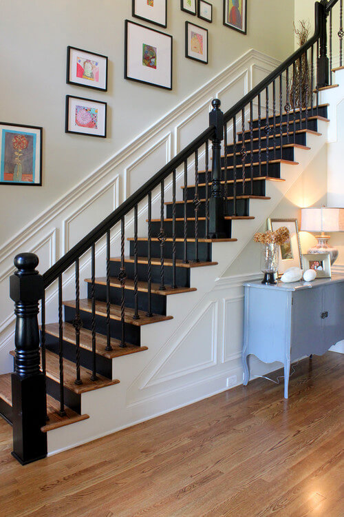 Black and white staircase with wall art decor