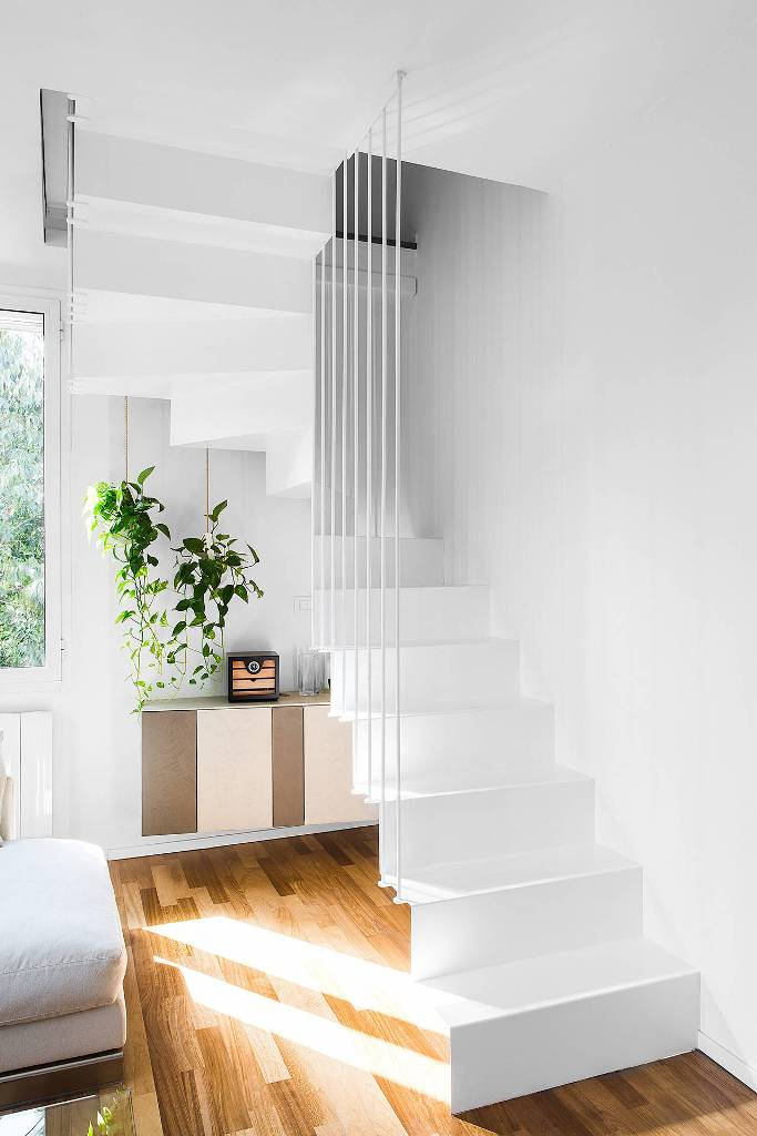 Small space in wooden floor under staircase plant decor