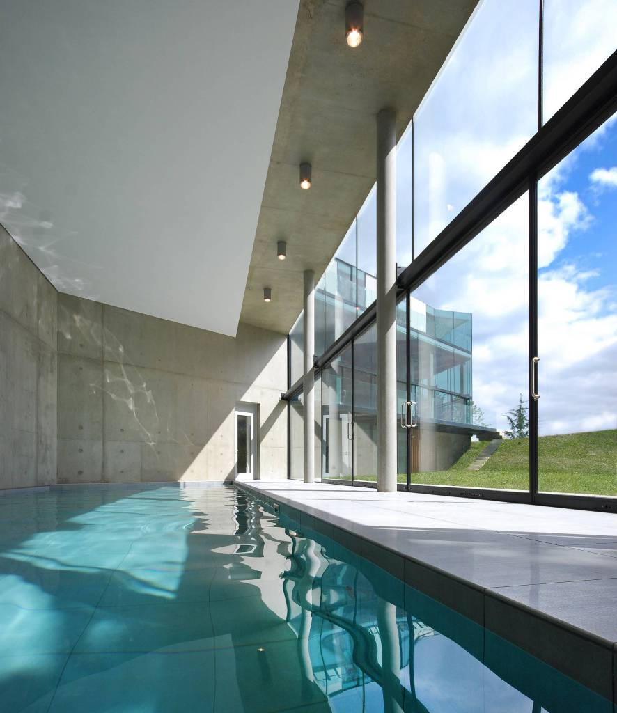 Massive glass windows with sunlight in the pool