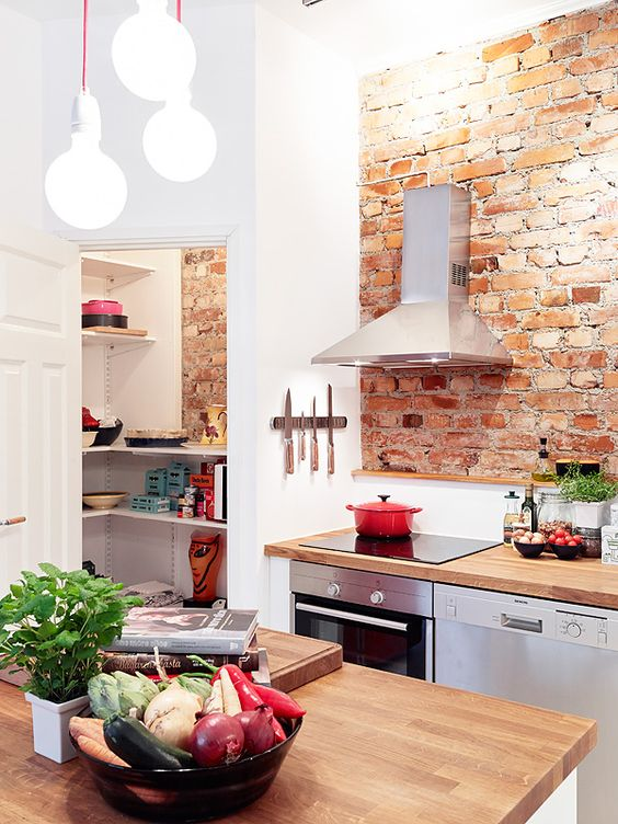 Exposed brick kitchen design with pantry