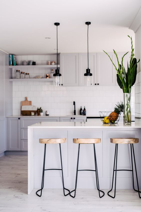 Minimalist white kitchen with pallets and lamps