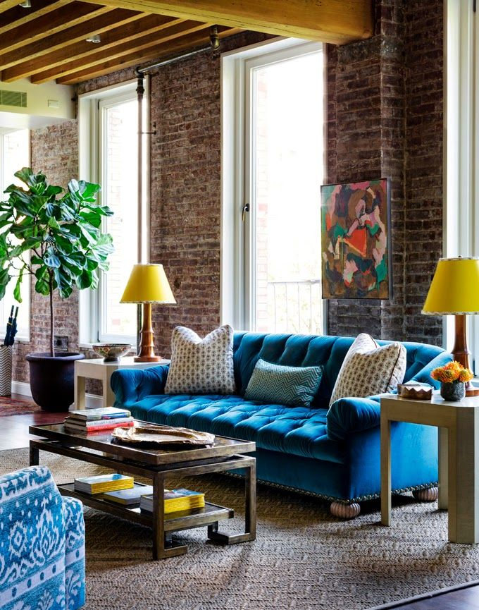 Living room with high ceiling brick wall