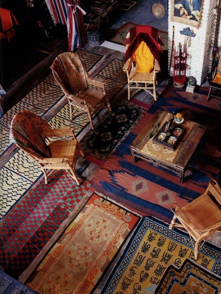 Layered carpet decor in bohemian living room