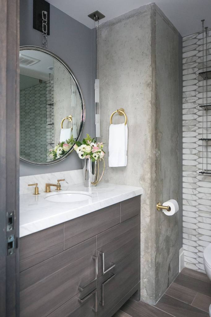 Bathroom decor with marble and mirror