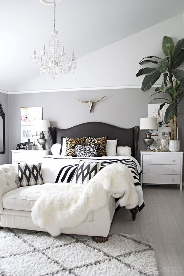 Neutral white bedroom with crystal chandelier