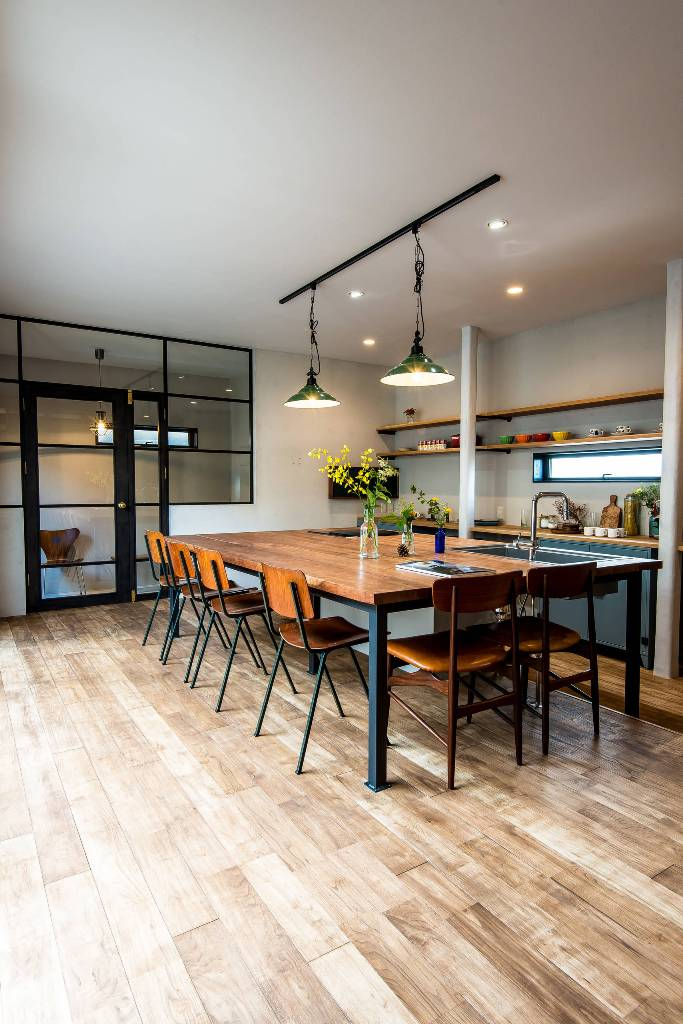 Kitchen with wooden floor and dining room