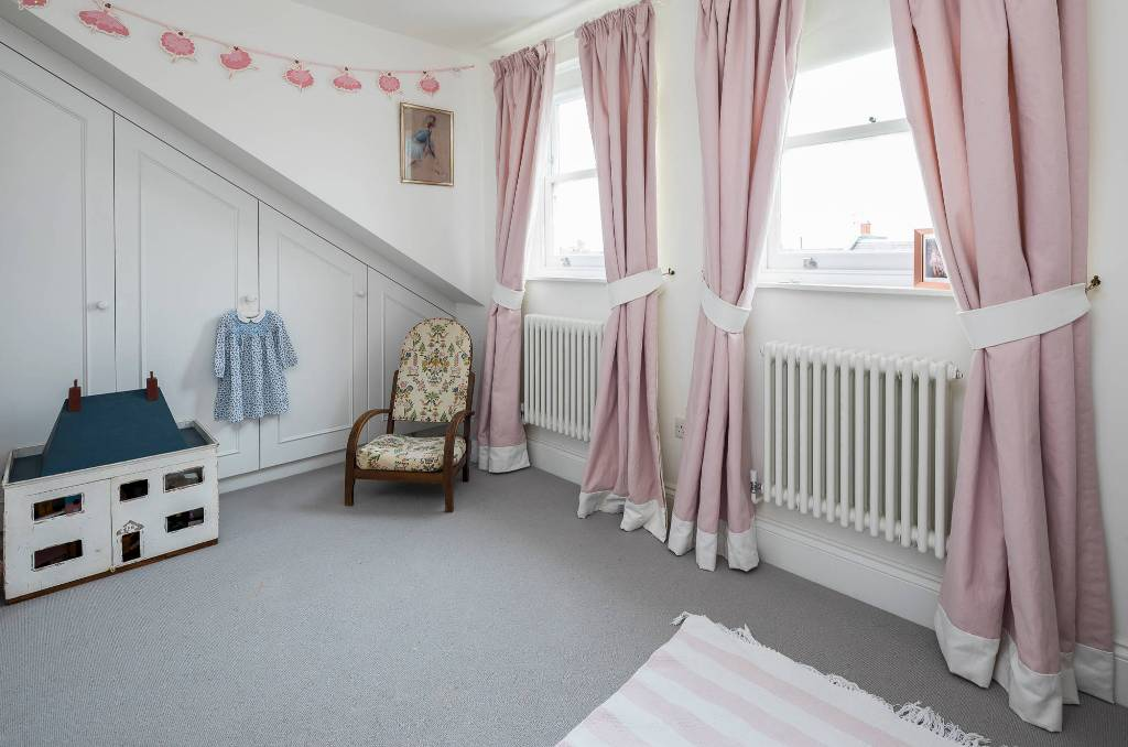 Girls' bedroom with pink curtains