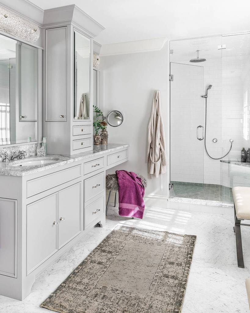 White bathroom design with traditional rug