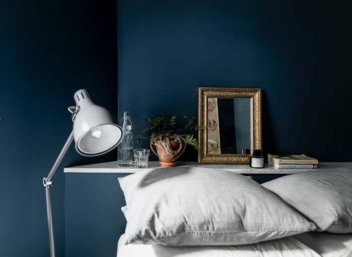 deep blue wall bedroom gray bedding