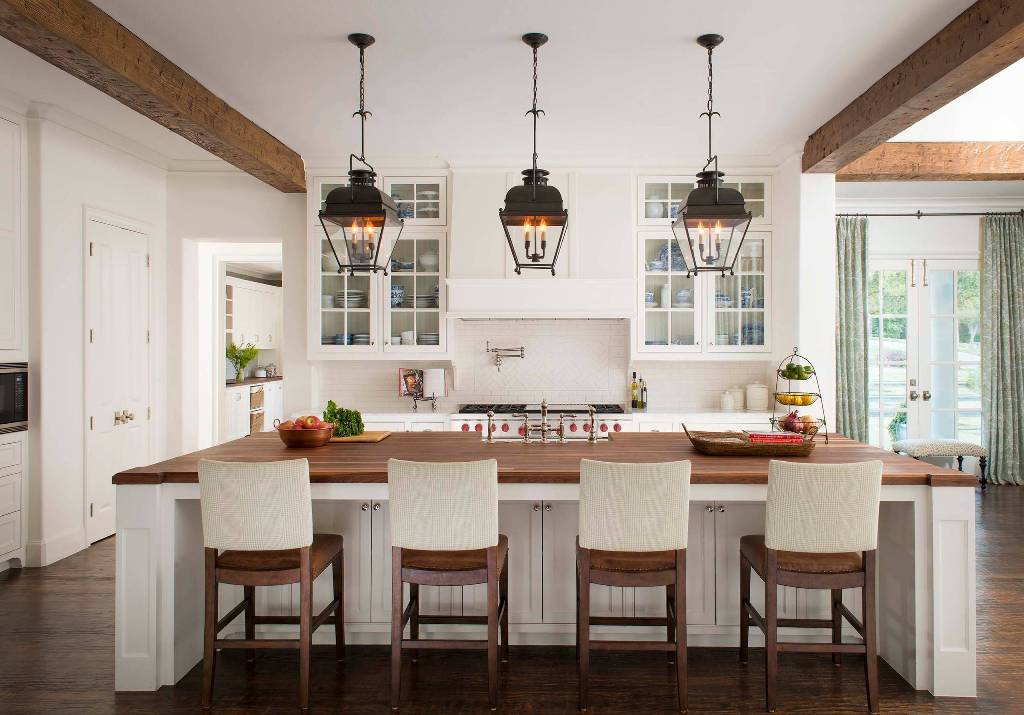 Kitchen with wooden dining table hanging lamp