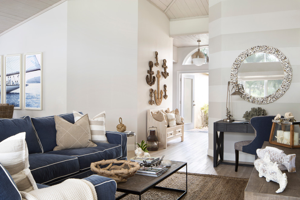 Nautical Living with navy blue sofa, white natural textures