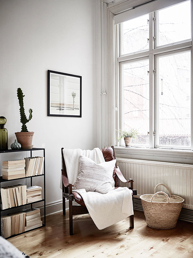 small bedroom armchair near the window