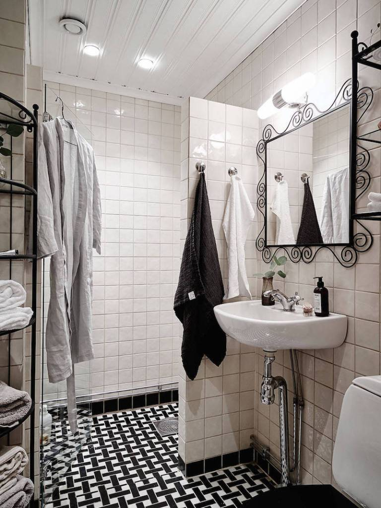 Scandinavian Style Mix of black and white bathroom black floor