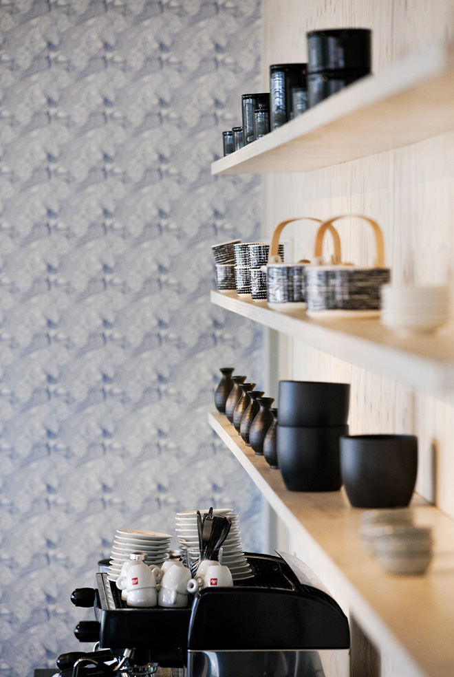 Black kitchen accessories and wooden shelves