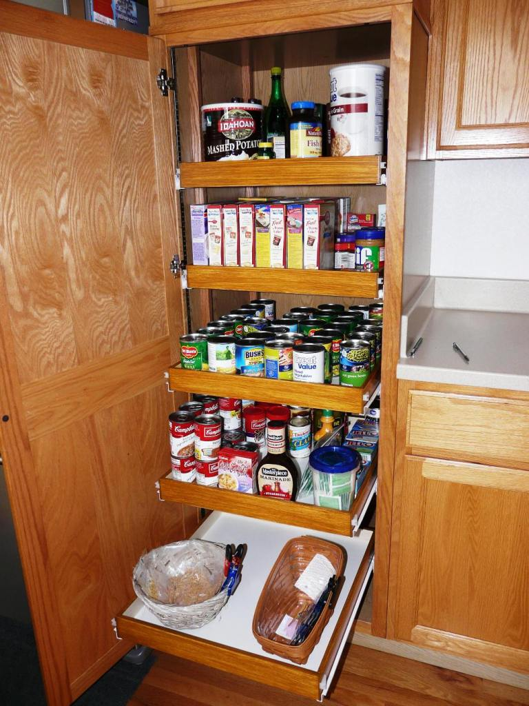 The kitchen cabinet pulls out shelf storage