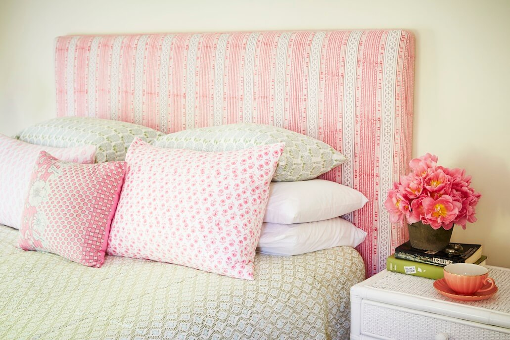 Arrange the pillow on a bed